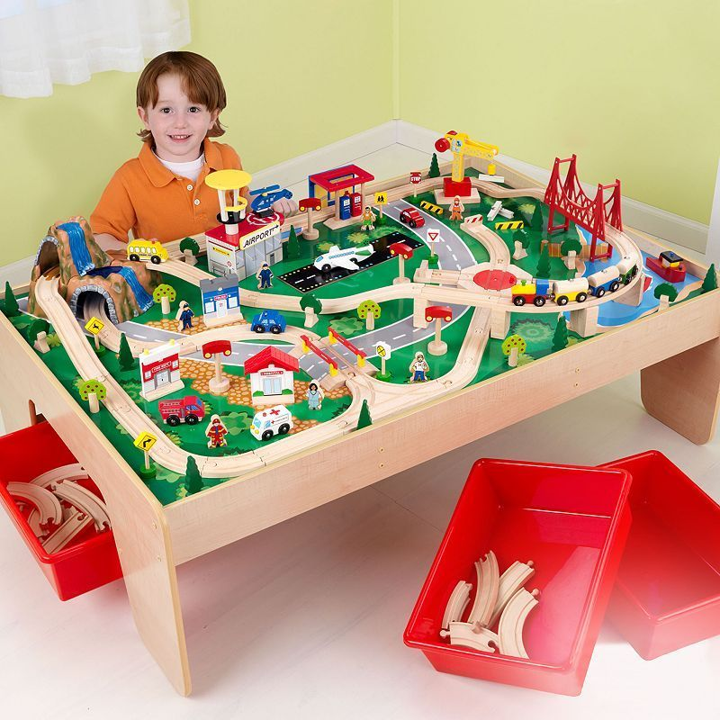 Toddlers playing with Wooden Train Set
