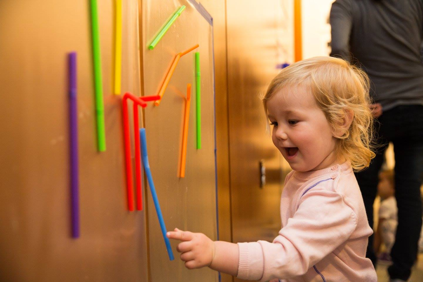 Toddlers Playing with Colorful Straws